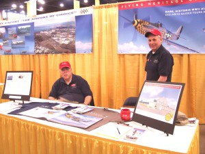 Volunteer docents Norm Gordon (left) and John Campbell manned the booth for the Flying Heritage Collection. An artist's rendition shows the new hangar that's being converted to display the planes at Paine Field.