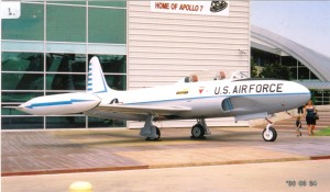 A Lockheed T-33, a two-seated trainer variant of the P-80 Shooting Star, guards the entrance to the Frontiers of Flight Museum.