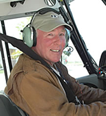 Artist Barry Ross sits at the controls of his Citabria.