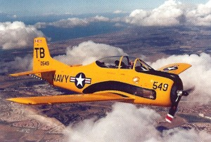 "Julie Clark named her North American T-28C Trojan Top Banana, in honor of Hughes Airwest, ""Top Banana of the West."" She flies the bright yellow aircraft for fun and sometimes uses it for formation flying."