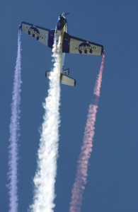 Julie Clark, in her T-34, climbs vertically into the blue skies of Dayton, Ohio.