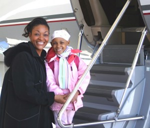 Natalie, a 6-year-old cancer patient, boards PepsiCo's airplane with and her mother.