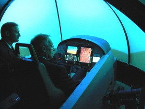 On his visit, Senator Wayne Allard flew ATG's flight simulator and was given a company briefing.
