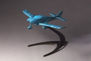 This sculpture, modeled in a dramatic blue marble patina, is fashioned after The New Spirit of St. Louis, the Lancair Columbia 300 that Erik Lindbergh used during his transatlantic flight.