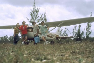 The author poses with travel companions and Cessna 12502 at Marsh Harbour Airport, Bahamas, in 1976.