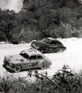 Hershel McGriff passes Lewis Hawkins on the torturous final leg in the mountains near Guatemala. As he crossed the finish line at El Ocotal, McGriff hit a dip in the road and ripped holes in the Oldsmobile's crankcase and fuel tank.
