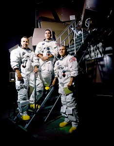 The Apollo 8 crew poses on a Kennedy Space Center simulator in their spacesuits. L to R: Jim Lovell, Bill Anders and Frank Borman.