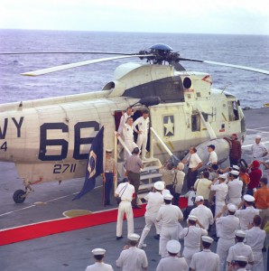 Apollo 8 splashed down on Dec. 27, 1968, in the Pacific Ocean, approx. 1,000 miles south-southwest of Hawaii. Frank Borman (left foreground), Jim Lovell and Bill Anders (right) are shown in the doorway of the rescue helicopter, aboard the USS Yorktown.