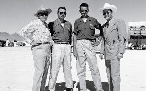 From right: cowboy actor Roy Rogers, National Hot Rod Association founder Wally Parks, Robert E. Petersen and an unknown cowboy enjoy a day at the lakebed races.