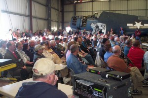 Attendees filled the Enterprise Hangar; standing room extended outside the hangar doors.