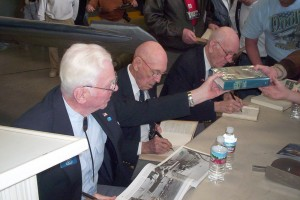 L to R: Col. John Doolittle; Lt. Col. Richard Cole, Doolittle's copilot on the famous raid; and Maj. Tom Griffin, navigator on another of the raid's B-25s, were kept busy signing autographs.