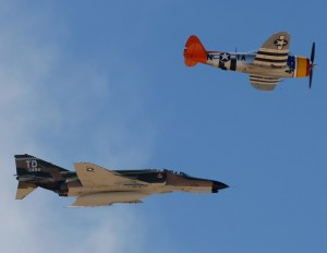 An F-4 Phantom and a P-47 fly in formation.