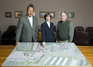 Dr. Bonnie Dunbar, Museum of Flight CEO, points to the museum's new site for exhibits and Aviation High School. With her are Mark Robison, Container Properties (left), and Ron Kreizenbeck, EPA deputy regional administrator.