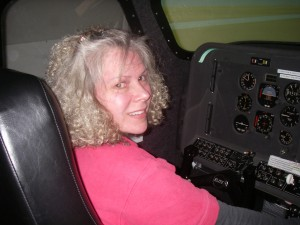 Lisa Neifert, owner of Advanced Aviation Simulators, is in the left seat of the ELITE King Air 200 simulator.