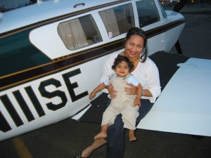 Entrepreneur Asavri Gupte, holding son Samir, plans to create more aviation-related products for children, including books, apparel and useful travel gear.