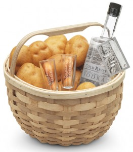 Maine Distilleries offers unique gifts, including this potato basket containing a bottle of Cold River Vodka, two vodka glasses and a pile of Green Thumb Farms gourmet potatoes—all from Maine.