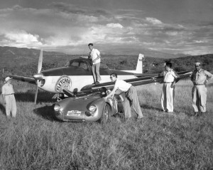 In 1953, Fletcher Aviation, a licensed builder of Porsche engines in the U.S., provided air transportation for key crew members of the German team, shown with Karl Kling's Por-sche 550.