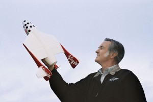 Burt Rutan displays a model of the revolutionary mother ship WhiteKnightTwo.