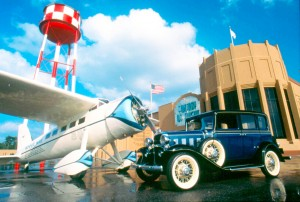 "History and aircraft—like this Lockheed Vega, shown with a '32 Chevy Sedan—will be used as a means to an end. Kermit Weeks plans to use the metaphor of flight, and entertainment, to help visitors ""self-discover their own human experience."""
