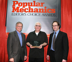 Jay LeBoff accepts an Editor's Choice Award at the 2005 Consumer Electronics Show for the HotSeat gaming chassis from Bill Congdon, publisher of Popular Mechanics (left) and Jim Meigs, editor-in-chief (right).
