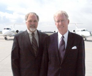 Dave Kempa (left) and Jim Huffman, Air Denver board member, predict that air charter will soon become a more common mode of transportation.