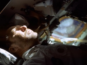 Wally Schirra looks out of the rendezvous window in front of the commander's station during the Apollo 7 mission.
