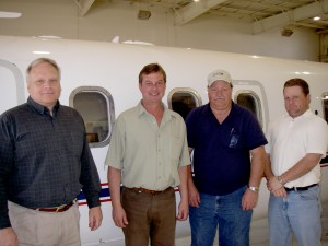 L to R: Dave Rommel, Kevin Burkhardt, Craig Orr and Jeff Rommel, in front of Trans Air's Westwind II.