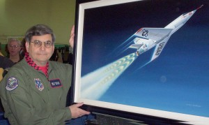 "Retired aviation artist Mike Machat had 22 prints, from his 250 paintings, installed permanently in the Syncro Aviation hangar's ""Historic Hallway,"" providing a walking tour through aviation history."