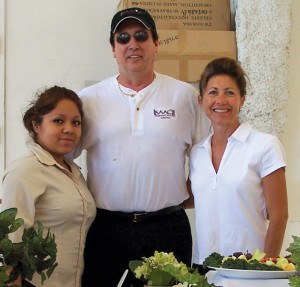 "At the 2006 Van Nuys Business Aircraft & Jet Preview, Richard Bier (center) and Isaac's Café and Catering staff members lived up to their motto, ""Exceeding the Expectations of Each Customer."""