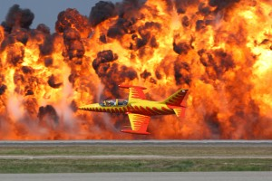 Rich Perkins, flying the Firecat, makes a low level pass in front of the wall of fire.