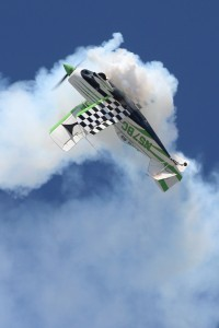 Bill Cornick gets inverted in a miniature loop in Big Bad Green, his Pitts S-2C biplane.