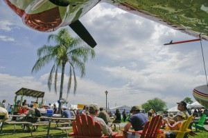 Florida's tropical colors are proudly displayed on lawn chairs and on a Widgeon seaplane, which doubly served as a spot of shade for Sun 'n Fun visitors.