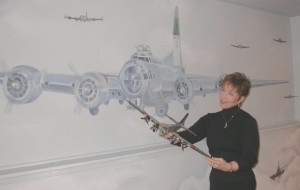 Pilot Melanie Jordan of Everett, Wash., likes this detailed B-17 model that complements the formation of B-17s painted in a surround-view in her recreation room.