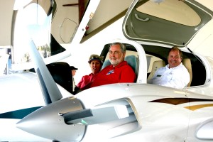 John Painter, CEO of Air Orlando Aviation, is in the pilot's seat of a Diamond DA-42 airplane. In the right seat is Painter's wife, Janet, and behind them is Michael Fabianac, Premier Orlando regional sales manager.