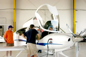 Attendees at the Premier Aircraft Sales open house admire a Diamond DA-40 aircraft.