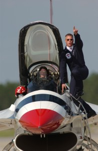 Staff Sgt. Dave Batterson, 2006 dedicated crew chief for Maj. Nicole Malachowski, Thunderbird #3, calls out the one-minute warning to engine start up at an air show at Tyndall Air Force Base, Fla. in April 2006.