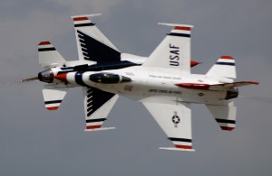 The Thunderbird solos perform the opposing knife edge pass at Scott Air Force Base, Ill. The Thunderbirds perform more than 65 shows annually across the United States and abroad.