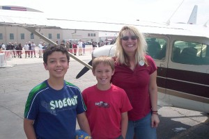 Stacie Crowther, with 12-year-old Alexis Suarez (left) and 11-year-old Mick Meyer, has flown more than 50 Young Eagles since she began flying four years ago. The 99s have nominated her for Pilot of the Year.