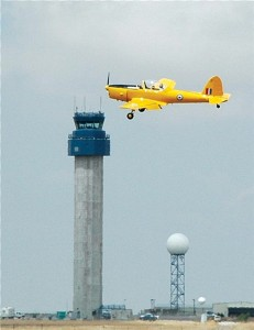 At last year's show, Jim McKinstry's 1950 de Havilland Chipmunk, awarded 2nd place in the warbirds category, flies past the tower.