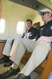 Diamond Aircraft representatives demonstrate how two tall men can be quite comfortable in the passenger cabin. Diamond states that the rear bench can seat three, but it appears it would be a friendly squeeze.
