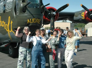 "L to R: Teachers Judy Cowper, Michele Gates, Kimberlee Hence, Phyllis Carr and Cathy McMaster join ""Rosie the Riveter,"" a Seattle Museum of Flight history actress, in front of the Collings Foundation's B-24 ""Witchcraft"" during its visit to Paine Field."