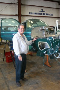 The 35 Bonanza behind Paul Camp, Air Salvage of Dallas president, is donating its useable components and avionics.