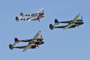 """Lightning Strikes!"" the P-38 Lightning formation flight, included Steve Hinton in Glacier Girl, followed by Kevin Eldridge in 23 Skidoo and Jeff Harris flying a silver Lightning."