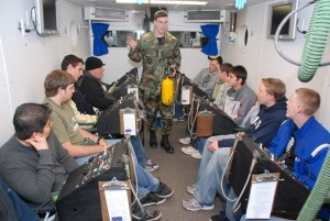 Students sit in the high altitude chamber while being taught about altitude sickness at Peterson Air Force Base.
