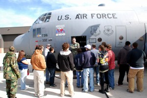 Students gather around a C-130 at Peterson Air Force Base.