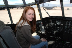 Emily Burley learns about the flight deck of a C-130 at Peterson Air Force Base.