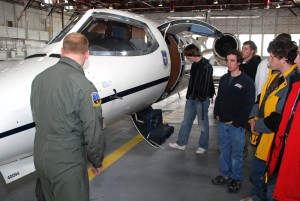 Students tour a military Learjet at Peterson Air Force Base.