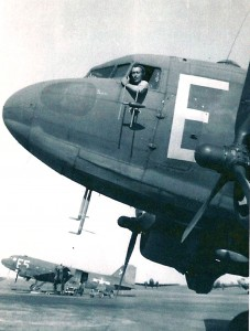 In a C-47, 1st Lt. Bill Johnson waits on the flight line in Poix, France, in May 1945.
