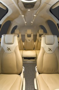 The cabin is spacious, and the flight deck offers modern amenities for the pilot and passengers. The middle seat slides back for more legroom.