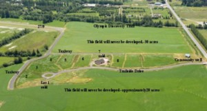 The highway entrance to the Discovery Trail Farm airpark, at right, leads to eight development sites. The taxiway connects with the runway of Sequim Valley Airport, at upper left. Fifty acres of land around the airpark will never be developed.